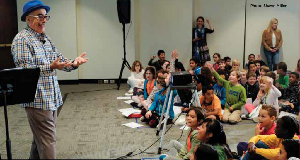 Poet Juan Felipe Herrera is shown celebrating Children's Day, Book Day with students in 2017.